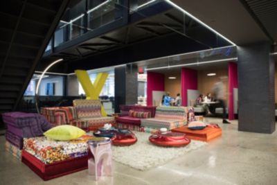 Roche bobois furnishes lounge in international architectural firm